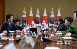 Japanese Prime Minister Shinzo Abe talks with South Korean President Park Geun-Hye during their meeting at the presidential house in Seoul, South Korea