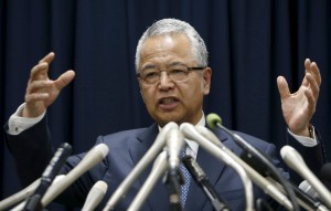Japan's Economics Minister Amari speaks during a news conference in Tokyo