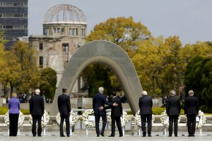 Kerry puts his arm around Kishida after they and fellow G7 foreign ministers laid wreaths at the cenotaph at Hiroshima Peace Memorial Park and Museum in Hiroshima, Japan