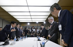 File photo shows Paul Krugman, Nobel Prize-winning economist and professor emeritus at Princeton University, greeted by Japan's Prime Minister Shinzo Abe at a meeting discussing global economy hosted by Abe in Tokyo