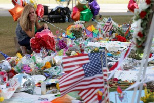 A woman visits the vigil site for the shooting victims at the Pulse gay nightclub in Orlando