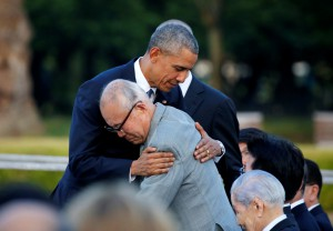 U.S. President Barack Obama hugs  atomic bomb survivor Mori as he visits Hiroshima Peace Memorial Park in Hiroshima, Japan