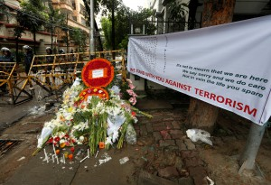 Wreaths and flowers, offered by people to pay tribute to the victims of the attack on the Holey Artisan Bakery and the O'Kitchen Restaurant, are pictured at a makeshift memorial near the attack site, in Dhaka