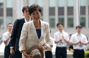 Tokyo's first woman governor Yuriko Koike arrives at Tokyo Metropolitan Government Building for her inauguration ceremony in Tokyo