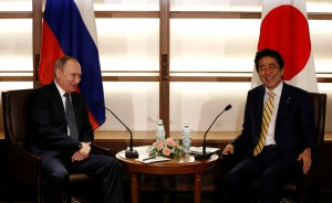 Russia's Presidentr Putin talks with Japan's PM Abe at the start of their summit meeting in Nagato